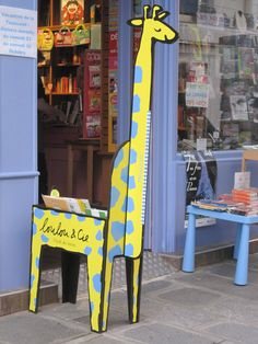 This colorful giraffe greets customers at this Parisian children's bookstore