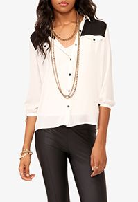Love this black and white color blocked blouse