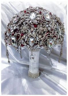 Ruby Red Silver colors in this Gatsby Luxury! High quality broaches, Swarovski crystals and hanging jeweled pieces make this bouquet full of