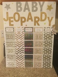 """Twinkle Twinkle Little Star Baby Shower Jeopardy. """"Answers"""" on back of pieces of paper with points and taped on with double sided tape."""