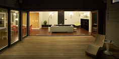 """""""Large, sliding doors open the living room to the patio, creating a seamless open space."""""""