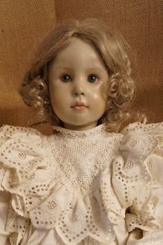 This very special doll was part of doll artist Pat Thompson's private doll collection.  According to the accompanying tag it is a French doll by doll