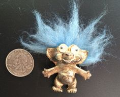 A personal favorite from my Etsy shop https://www.etsy.com/listing/274585186/vintage-metal-troll-brooch-with-wild