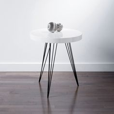 Hairpin tripod legs make this side table stand out from the pack. Unassuming but dapper, the Stortorvet Side Table will add style to your living room but could also be co-opted into a barebones nightst...  Find the Stortorvet Side Table, as seen in the Adventures in Oslo Collection at http://dotandbo.com/collections/adventures-in-oslo?utm_source=pinterest&utm_medium=organic&db_sku=104455