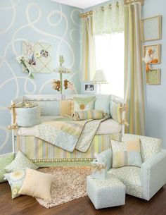 love the swirled wall and the pastel colors for a neutral nursery
