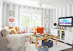 love this kids playroom w/ gray and white striped walls