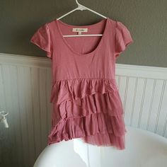 NWOT Steve Madden Top Selling a NWOT Steve Madden Top. This top has a- symmetrical look to it, very pretty blush pink, layered with ruffles and tulle. Small in size, just adorable! Tops Blouses