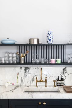 Kitchen Designed by Laura Butler-Madden - drop dry shelves above sink