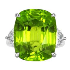 22.14 Carat Peridot Diamond Three Stone Ring | From a unique collection of vintage cocktail rings at http://www.1stdibs.com/jewelry/rings/cocktail-rings/
