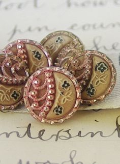 Tiny pink and gold steel cut Victorian buttons