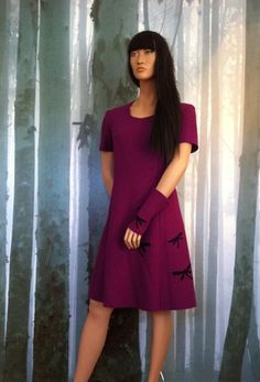 Minsin, cerise wool dress with black dragonflies. Short sleeves and wrist warmers.