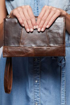 Patchwork Leather Clutch Constructed textured leather clutch with removable wristlet and zip closure. Material: 100% Leather with metal hardware