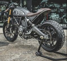 """Pretty sweet custom Ducati Scrambler built in a traditional cafe racer style. The """"Passion of Rocker"""" Cafe Racer by Zeus Customs as they've called it. Ducati Scrambler Custom, Bobber Custom, Triumph Cafe Racer, Custom Cafe Racer, Cafe Racer Build, Cafe Racer Motorcycle, Cafe Racer Bikes, Cafe Racers, Vintage Motorcycles"""