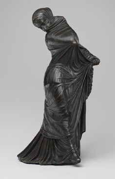 Hellenistic Greek Statuette of a veiled and masked dancer, c. 3rd - 2nd century BC