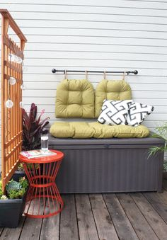 Up storage and seating on a small patio or balcony with this DIY storage bench via POPSUGAR Home.