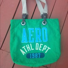 """Aeropostal Green Canvas Tote Aeropostale Green Canvas Tote.The canvas exterior is decorated with signature appliqes.Still in good condition.Came from a smoke and pet free home.W 17"""" x H 15"""" x D 4.5"""" Aeropostale Bags Totes"""