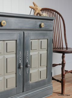 The body is painted with Chalk Paint® decorative paint by Annie Sloan. in Graphite. The door panels (aka the sandy beach)  the finish was done with French Linen and clear wax. Turnstyle Vogue