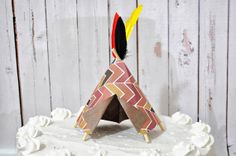 Paper Teepee Cake Topper by Msapple on Etsy, $5.00  Party attire for the cake!
