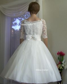 Ugh that is such a CUTE 50's wedding style dress
