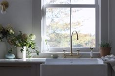 Farmhouse sink with brass faucet in Maine house designed by Jersey Ice Cream Co.
