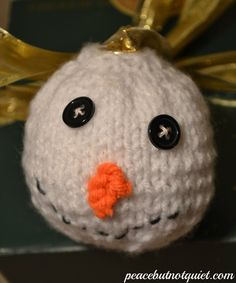 A fun little knit snowman ornament to hang on your tree, top your presents, or give to your neighbors!