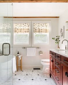 Warm tones and a polka dot hex floor pattern unite to create the ultimate cottage bathroom vibe🌿  Design by @beginninginthemiddle.  Tiles featured: Black Marquina 2in. Hex + Firenze Carrara 2in. Hex. Gray Vanity, Wood Vanity, Grey Accent Chair, Pillar Lights, Floor Patterns, Bathroom Design Inspiration, The Tile Shop, Black Tiles, Home Board