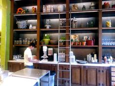 Chic modern library ladder from modernstainlessladders.com - We love the wine and juice bar set up #truefoodkitchen #unique #ladderbar #libraryladder #foodie #healthy #restaurant #santamonica #organic #ecochic  