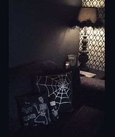 My @killinmesoftlydolls Edward doll goes perfectly with my couch! #killingmesoftlydolls It's hard to take pictures in my house bc everything is black haha...oh well!
