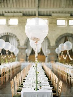 If a shiny mylar balloon sign seems a little too eccentric for your style, simple balloon centerpieces are fit for a more traditional wedding. Lined with garlands of flags, these balloon centerpieces look super elegant on long tables. Wedding Balloon Decorations, Wedding Balloons, Wedding Table Centerpieces, Reception Decorations, Birthday Balloons, Wedding Receptions, Decor Wedding, Reception Ideas, Reception Checklist