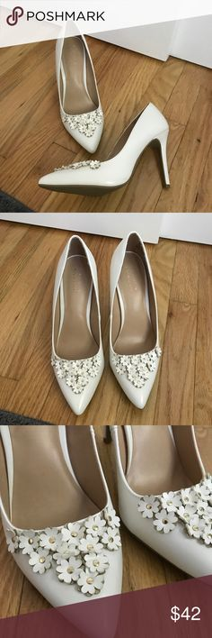 "Petal White Heels New, will come without the box. LC by Lauren Conrad. Size 9.5. White with flower detail in front. Heel measures 4 inches.  ❌ No trades or off Poshmark transactions.   Quick shipping.   Offers welcome through ""Make an Offer"" feature.    Bundle discount.   ❔ Feel free to ask any questions. LC Lauren Conrad Shoes Heels"