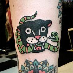 black panther biting snake, tattoo