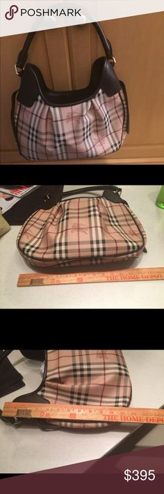 BURBERRY Authentic like new Haymarket Hobo Authentic like new Burberry Haymarket Hobo. No flaws. Includes dustcover.  Inside has one zippered compartment on one side and two non zippered pockets on the other. It measures 14 inches across and 9 inches high. The handle is an 8 1/2 inch drop.  This really is a gorgeous, classic bag you can hardly tell it is pre owned. Please message me with any questions. Burberry Bags Hobos