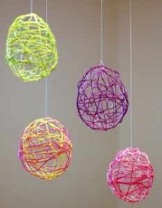 Easter Egg decorations from balloons covered with embroidery thread soaked in fabric stiffener.