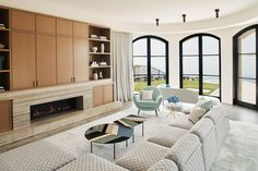 Newport Beach House Family Room | Custom design and bright natural light with ocean views Newport Beach House, Ocean Views, Interior Design Living Room, Natural Light, Interior Architecture, Family Room, Custom Design, Bright, Fireplaces
