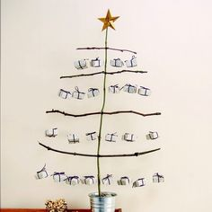 Advent tree - include different elements for nature/advent table, simple materials for kid crafts, and festive tasks. Unusual Christmas Trees, Handmade Christmas Decorations, Xmas Tree, Holiday Crafts, Christmas Countdown, Christmas And New Year, Winter Christmas, Diy Advent Calendar, Advent Calendars