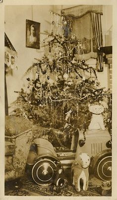 Old Christmas photo..gifts under the tree. vintage pedal car