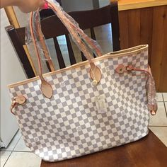 Large cream colored checkered bag PRICE REFLECTS PLEASE DONT ASK!! Come with dust bag. Still had tag never been used its brand new. Perfect condition! Comes with dust bag. Size is GM. Let me know if you have any questions. NO TRADES! Make offer through offer button I'm open to negotiation. Bags Totes