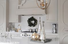 Custom Cabinetry Designed by Courtney Shearer decorated for the Holidays. Elegant decor and style.