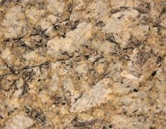 Persian Pearl   This granite has significant movement from the veining and mica and can pick up a number of different colors in a kitchen design. Would definitely work with natural wood or painted cabinets