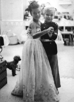 Grace & Family: Princess Caroline and Prince Albert posing for their father, Prince Rainier III. Monaco, November 19, 1963.