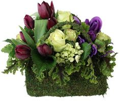 Beautiful arrangement in moss covered container - just gave a friend a similar arrangement - love it!