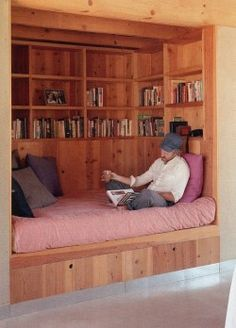 Build into the basement, or for an apartment-bookshelves and a DIY bed platform!!