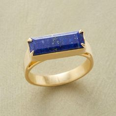 LAPIS LATITUDE RING--Distinctive for its rich hue and slender baguette cut, our singular deep blue lapis ring is prong set with an elevated bezel. 10kt goldplate. Handcrafted by Jane Diaz. Whole sizes 5 to 9.