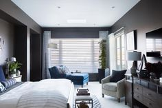 With a deep, moody charcoal color on all four walls, an inviting queen bed and smart features that make the space comfortable and user-friendly, the swanky master bedroom offers a luxurious and private retreat from the rest of the home. Hgtv Smart Home 2017, Bedroom With Sitting Area, Bedroom Seating, Coastal Bedrooms, Southwestern Decorating, Bedroom Pictures, Bedroom Ideas, Queen Beds, Master Bedroom