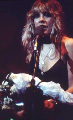 Stevie onstage  ~ ☆♥❤♥☆ ~   at the end of a concert holding a bouquet of flowers, May 16th, 1977, The Summit, Houston, Texas