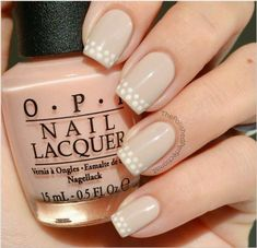 This playful twist on a traditional French manicure is easy to re-create and subtle enough to match every look in your closet. #NailArt #Nails