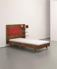 Gio Ponti; Walnut, Glass, Brass and Painted Metal Bed with Integrated Shelving, 1950s.