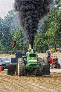 John Deere Tractors do well at tractor pulling contest. Going by the exhaust this one has been souped up just a tiny bit.