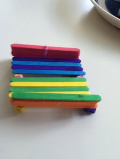 Cute DIY phone case . By using only Popsicle sticks ,hot glue and string.