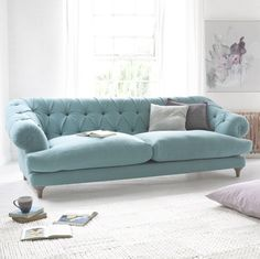 Styled chesterfield Bagsie sofa in blue linen